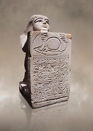 Ancient Egyptian stelophorus statue of Ubenre, New Kingdom, 19th-20th Dynasty, (1292-1076 BC), Deir el-Medina, Egyptian Museum, Turin. Cat 3040. <br /> <br /> This type of stele is so called stelophorous statue. It consists of kneeling figure holding or offering stele. They were produced from the 18th dynasty onwards. Such stelae were usually inscribed with hymns to the sun-god. .<br /> <br /> If you prefer to buy from our ALAMY PHOTO LIBRARY  Collection visit : https://www.alamy.com/portfolio/paul-williams-funkystock/ancient-egyptian-art-artefacts.html  . Type -   Turin   - into the LOWER SEARCH WITHIN GALLERY box. Refine search by adding background colour, subject etc<br /> <br /> Visit our ANCIENT WORLD PHOTO COLLECTIONS for more photos to download or buy as wall art prints https://funkystock.photoshelter.com/gallery-collection/Ancient-World-Art-Antiquities-Historic-Sites-Pictures-Images-of/C00006u26yqSkDOM