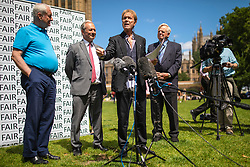 © Licensed to London News Pictures. 01/07/2019. London, UK. Sir Cliff Richard (centre) joins Paul Gambaccini (L) and others at the launch of a campaign calling for a ban on naming sex crime suspects unless they have been charged. Photo credit: Rob Pinney/LNP
