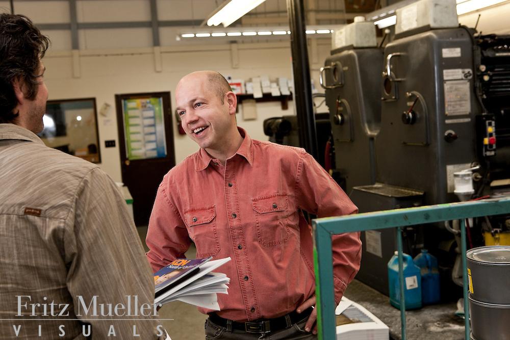 Greg Karais of Harper Street Publishing does a press check of his magazine North of Ordinary