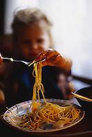 ca. December 1999, Paris, France --- Little Girl Eating Spaghetti --- Image by © Owen Franken/CORBIS