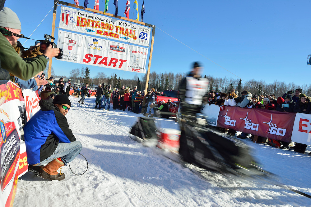 Dallas Seavey, this year's winner, who finished in record time, leaves the re-start line in Willow Alaska. 2014 Iditarod race.