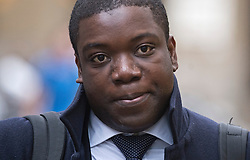 © London News Pictures. 15/11/2012. London, UK . Former UBS trader Kweku Adoboli arriving at Southwark Crown Court in London, where a  jury has retired to consider its verdict in the trial of the City trader accused of a $2bn fraud. Adoboli is accused of undertaking unauthorised trading at Swiss bank UBS that resulted in a $2bn loss for the bank, one of the biggest ever cases of alleged unauthorised trading. Photo credit: Ben Cawthra/LNP