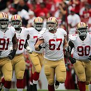 The 49ers defense during an NFL football game between the San Francisco 49ers  and the Tampa Bay Buccaneers on Sunday, December 15, 2013 at Raymond James Stadium in Tampa, Florida.. (Photo/Alex Menendez)