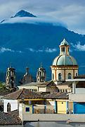 The Cotacachi Volcano creates a dramatic backdrop for the Church of Jordan in Otavalo, Ecuador.