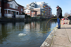 © licensed to London News Pictures. London, UK 08/03/2012. A police marine searches Regents Canal in east London where a torso, thought to be that of TV actress Gemma McCluskie's  was found yesterday. Photo credit: Tolga Akmen/LNP