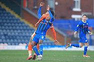 Kgosi Nthle is challenged during the EFL Sky Bet League 1 match between Rochdale and Shrewsbury Town at Spotland, Rochdale, England on 9 March 2019.