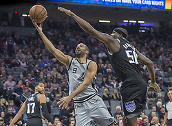 December 23, 2017 - Sacramento, CA, USA - The San Antonio Spurs' Tony Parker (9) goes to the basket against the Sacramento Kings' Zach Randolph (50) on Saturday, Dec. 23, 2017, at Golden 1 Center in Sacramento, Calif. (Credit Image: © Hector Amezcua/TNS via ZUMA Wire)