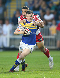 Leeds Rhinos Jordan Lilley is tackled by Leigh Centurions Kevin Larroyer during the Ladbrokes Challenge Cup, quarter final match at the LD Nutrition Stadium, Featherstone.