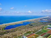 Nederland, Noord-Holland, gemeente Schagen, 07-05-2021; tussen Callantsoog en Sint Maartenszee, zicht op de Noordzeekust en Zwanenwater (Tweede water). Natuurgebeid van Natuurmonumenten.<br /> Between Callantsoog and Sint Maartenszee, view of the North Sea coast and Zwanenwater (Second water). Nature area of Natuurmonumenten.<br /> <br /> luchtfoto (toeslag op standaard tarieven);<br /> aerial photo (additional fee required)<br /> copyright © 2021 foto/photo Siebe Swart