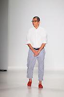 Designer Tadashi Shoji greets the audience after presenting the Tadashi Shoji Spring 2015 fashion show during Mecedes-Benz Fashion Week in New York on September 4th, 2014