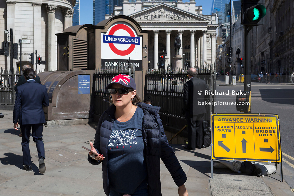 A woman wears a Union Jack cap outside one entrance of Bank Underground Station in the City of London, the capital's ancient, financial district, on 14th May, in London, England. (Photo by Richard Baker / In Pictures via Getty Images)