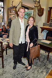 LOTTY BENNETT and JUSTIN GREEN at a private view of photographs by Gray Malin 'Beaches' held at Huntsman, 11Savile Row, London on 20th June 2016.