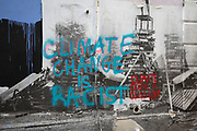 Climate Change is racist graffiti in London, England, United Kingdom.