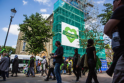 London, UK. 14th June, 2018. Members of the Grenfell community pass in front of the Baptist Church on the first anniversary of the Grenfell Tower fire. 72 people died in the Grenfell Tower fire and over 70 were injured.