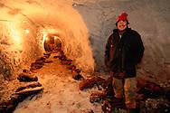Chukchi hunter Yevgenij Sivu-Sivu in his underground perma-frost freezer, Chukotka, Siberia, Russia