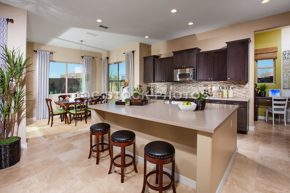 Kitchen with Limestone Tile Flooring and Dark Brown Cabinets