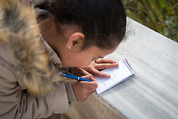16 February 2020, Irbid, Jordan: Eight-year-old Jordanian girl Shimaa writes down her name after participating in a psychosocial support session for Syrian refugees and Jordanian host community families, organized by the Lutheran World Federation.