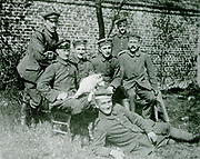 Adolf Hitler, seated on the right, with fellow German soldiers during World War I.