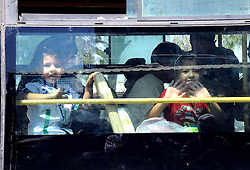 DAMASCUS, Sept. 2, 2016 (Xinhua) -- Syrian kids look out of a bus window as they were evacuated from the rebel-held town of Muadamiyeh, in rural Damascus, capital of Syria, on Sept. 2, 2016. Nearly 300 civilians, who were originally from the town of Daraya for refuge, were evacuated from Muadamiyeh to government-controlled shelters in southern Damascus. (Xinhua/Ammar) (Credit Image: © Ammar/Xinhua via ZUMA Wire)