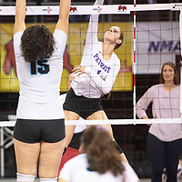 Miyamura's Madison Hyatt (1) goes up for a spike in their match against Santa Teresa Thursday morning at the Santa Ana Star Center in the NMAA Class 4A State Volleyball tournament in Rio Rancho.