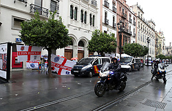 Police arrive to take down banners put up by England fans prior to the Nations League match at Benito Villamarin Stadium, Seville.