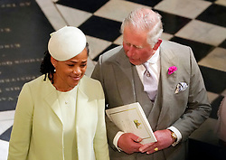 The Prince of Wales and Doria Ragland, mother of the bride, depart from St George's Chapel in Windsor Castle after the wedding of Prince Harry and Meghan Markle.