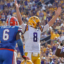 Oct 12, 2013; Baton Rouge, LA, USA; LSU Tigers quarterback Zach Mettenberger (8) signals touchdown following a score during the second quarter of a game against the Florida Gators at Tiger Stadium. Mandatory Credit: Derick E. Hingle-USA TODAY Sports