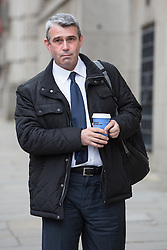 © Licensed to London News Pictures. 18/03/2014. London, UK. Mark Hannah arrives at The Old Bailey in London this morning, 18th March 2014 for the continuation of the Phone Hacking Trial.Photo credit : Vickie Flores/LNP