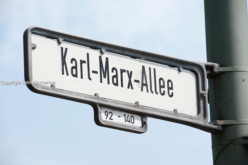 Detail of road sign on historic Karl Marx Allee in Berlin Germany