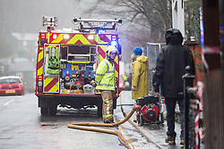 © Licensed to London News Pictures. 22/12/2015. Glenridding UK. Picture shows the fire brigade pumping water out of the Glenridding Hotel. The village of Glenridding that flooded twice in one week in the last round of bad weather is preparing for more floods after days of heavy rain. Photo credit: Andrew McCaren/LNP