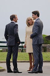 French President Emmanuel Macron and his wife Brigitte Macron welcome Canadian Prime Minister Justin Trudeau at the Biarritz lighthouse, southwestern France, ahead of a working dinner on August 24, 2019, on the first day of the annual G7 Summit. Photo by Thibaud Moritz/ABACAPRESS.COM