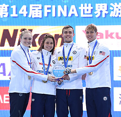 December 12, 2018 - Hangzhou, China - Team USA poses for photo during the awarding ceremony of Mixed 4x50m Freestyle Final at 14th FINA World Swimming Championships (25m) in Hangzhou, east China's Zhejiang Province. (Credit Image: © Xinhua via ZUMA Wire)