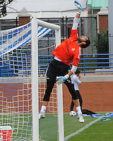 Football - Real Madrid Training for St. Louis Game against Inter Milan.  The Real Madrid team held a practice session on Thursday August 8, 2013 in St. Louis, Missouri, USA at the Robert Hermann Stadium located on the campus of St. Louis University in St. Louis.  Here, keeper Diego Lopez Rodriguez leaps and deflects a ball over the goal during goalkeeper training.