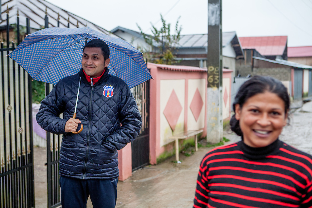 Portrait of Dumitru Nica Florin (left) who is one of six elected Roma local councilors in the village of Marginenii de Jos, beside this he is trainer of the local football team.