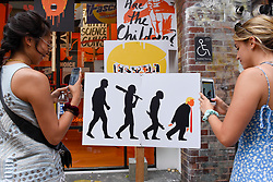 "© Licensed to London News Pictures. 02/06/2019. LONDON, UK.  An exhibition of artwork entitled ""Hell is Empty"" by Edel Rodriguez depicting Donald Trump is on display near Brick Lane in East London.  Donald Trump is due to arrive on a State Visit to the UK on 3 June.  Photo credit: Stephen Chung/LNP"