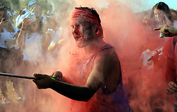 August 25, 2017 - Amman, Jordan - People take part in the Color Run in Amman. Jordanians enjoyed the color, dancing and music of the country's second color run. (Credit Image: © Mohammad Abu Ghosh/Xinhua via ZUMA Wire)