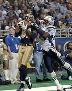 St. Louis Rams wide receiver Torry Holt (81) catches a 16-yard touchdown pass from quarterback Marc Bulger, over New England defensive back Earthwind Moreland (29) early in the fourth quarter.  The Rams cut the Patriots lead to 33-22 but lost 40-22 in St. Louis, Missouri, November 7, 2004.