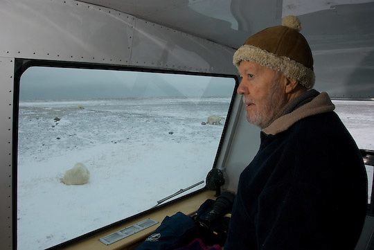 Fred Bruemmer viewing and photographing polar bears from a Tundra Buggy.