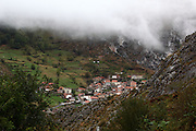 A view of the hamlet of Beges, on the eastern side of the Picos de Europa national park in northern Spain, as the fog descends over the rooftops