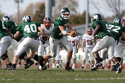 10 November 2007: Kraig Ladd hands off the ball to Marcus Dunlop.  This game between the Wheaton College Thunder and the Illinois Wesleyan University Titans was for a share of the CCIW Championship and was played at Wilder Field on the campus of Illinois Wesleyan University in Bloomington Illinois.
