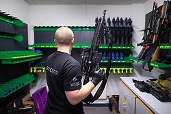 © Licensed to London News Pictures . 13/06/2019. Manchester , UK . A police issue Heckler and Koch 416 semi automatic assault rifle , of the type used by police marksman . Inside Greater Manchester Police's weapons store at Claytonbrook in Openshaw where police issue firearms and recovered weapons are held . Photo credit : Joel Goodman/LNP