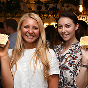 Brit Woodruff,@naturally.b & Katie forbes,@katieforbesfitness attend the Oppo party to launch its new Madagascan Vanilla, Sicilian Lemon and Raspberry Cheesecakes, served with Skinny Prosecco at Farm Girls Café, 1 Carnaby Street, Soho, London, UK on July 18 2018.