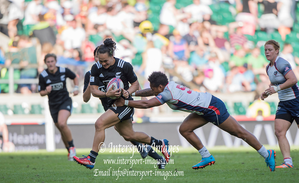 Twickenham, Great Britain, New Zealand's Portia WOODMAN, breaking with the ball is tackled by USA's.  Akalaini BARAVILALA, during the 3/4th place match, NZL vs USA. at the Marriott London Sevens played at the  RFU Stadium, Twickenham, ENGLAND. Saturday 16.05.2015<br /> [Mandatory Credit; Peter Spurrier/Intersport-images]