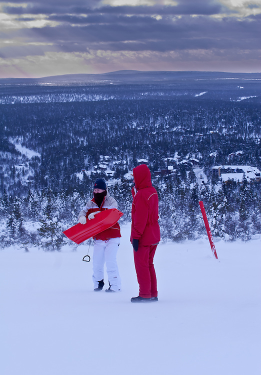 Tourists prepare themselves to sledge down into Saariselkä fell village in Lapland, Finland.