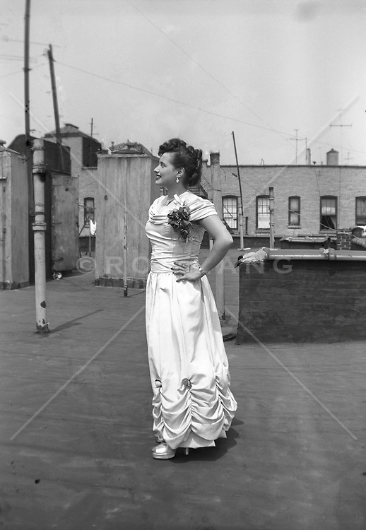 Woman in a dress standing on a NYC rooftop in The Bronx