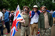 London, UK. Tuesday 7th August 2012. Men's Triathlon held in Hyde Park. Team GB fans dressed in colonial outfits with pith helmets and khaki clothes.