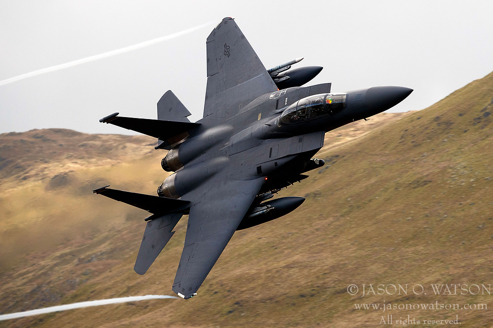 United States Air Force McDonnell-Douglas F-15E Strike Eagle (LN 91-326) from the 48th Fighter Wing, 494th Fighter Squadron based at RAF Lakenheath, England, flies low level through the Mach Loop, Machynlleth, Wales, United Kingdom