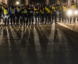 London, November 5th 2016. Anti-capitalists and anarchists participate in the Million Mask March, an annual event that happens on November 5th each year in cities across the world, as part of a protest against the establishment. Many of the protesters wear Guy Fawkes masks, often associated with the internet activism group Anonymous. PICTURED: A line of police at Admiralty Arch casts shadows on the street.