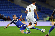 Cardiff City's Joe Ralls (on floor) challenges Hull's Tom Huddlestone. Skybet football league championship match, Cardiff city v Hull city at the Cardiff city stadium in Cardiff, South Wales on Tuesday 15th Sept 2015.<br /> pic by Carl Robertson, Andrew Orchard sports photography.