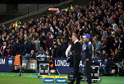 West Ham United fans throw an inflatable around the stands during the match